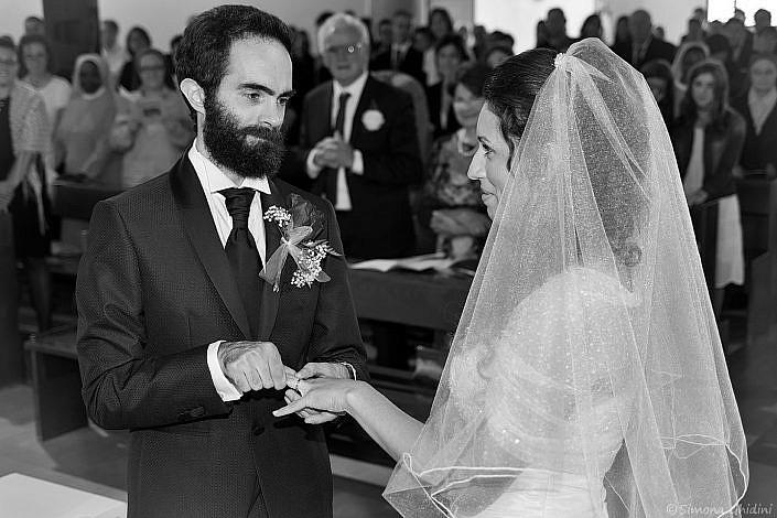 Servizio fotografico per matrimonio con scambio anelli sposi